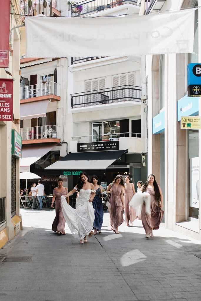 bride and bridesmaids in streets of sitges, spain, barcelona brides