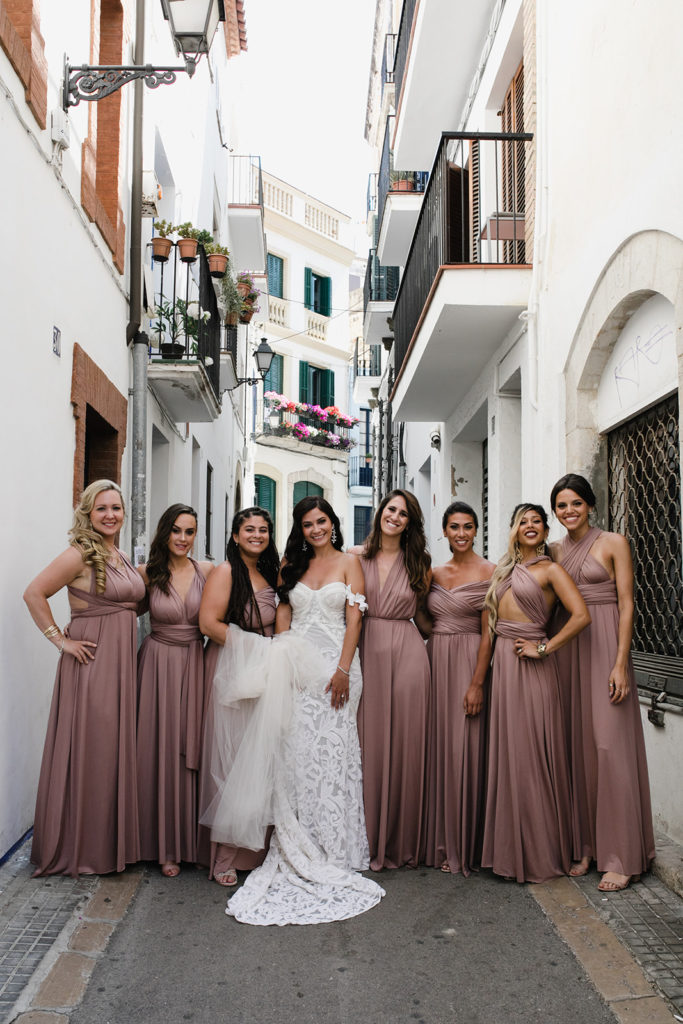 bride and her bridesmaids in the streets of sitges, spain, barcelona brides