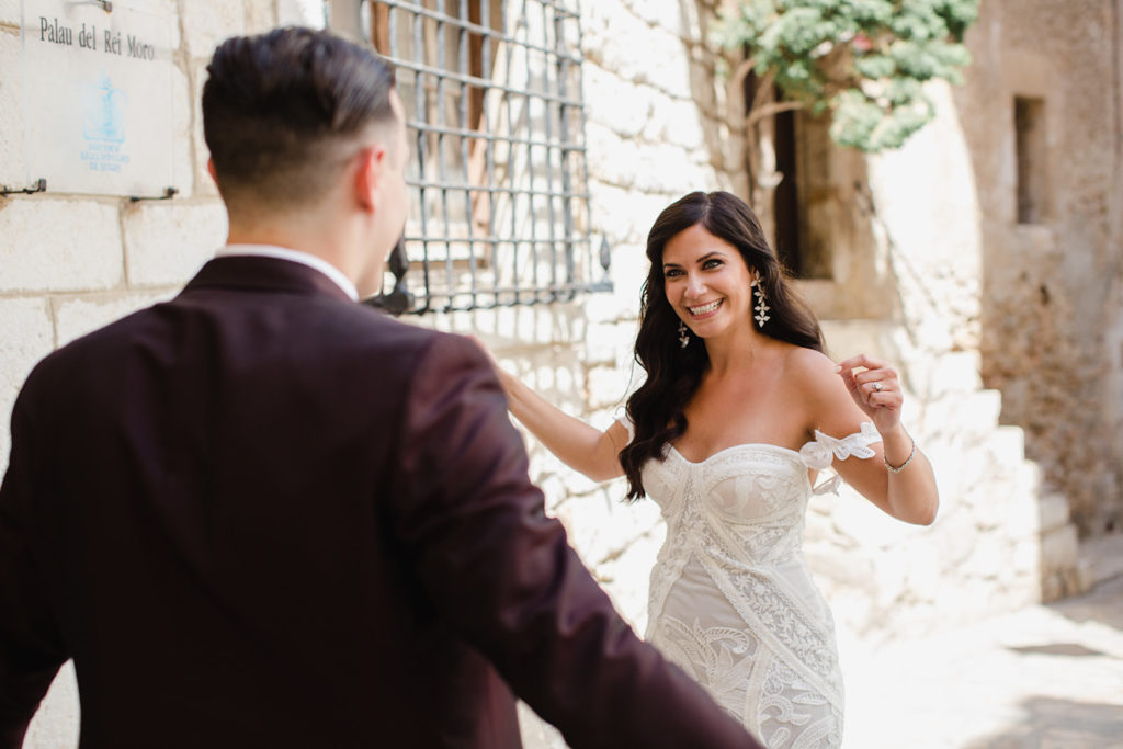 bride and groom smile in first reveal outside casa del mar, sitges, spain