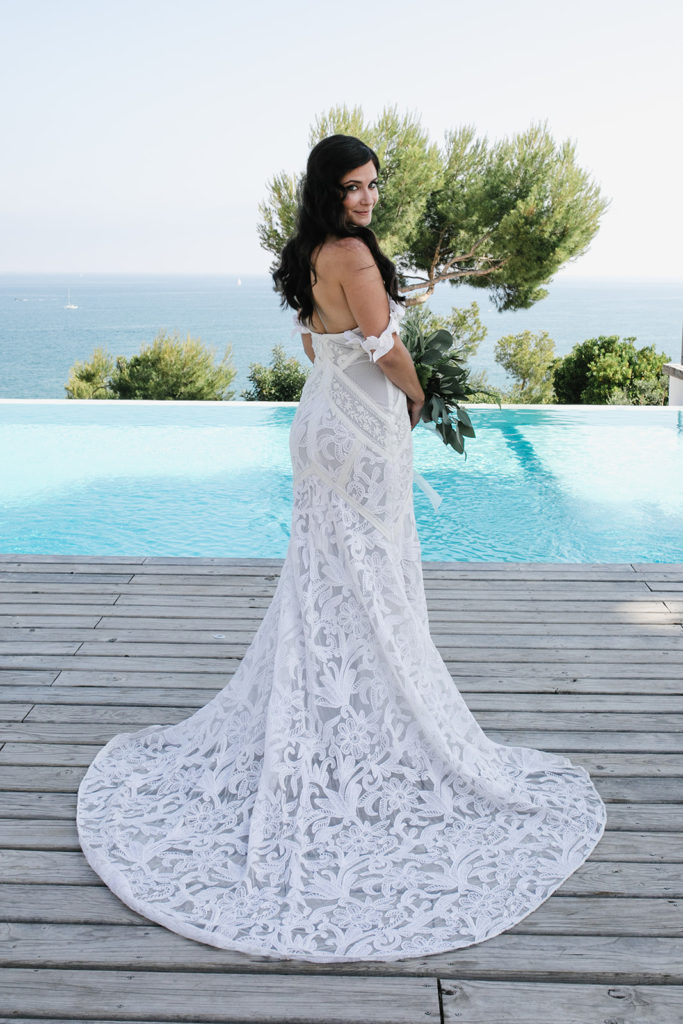 bride in lace wedding gown by the pool at casa del mar, sitges, spain