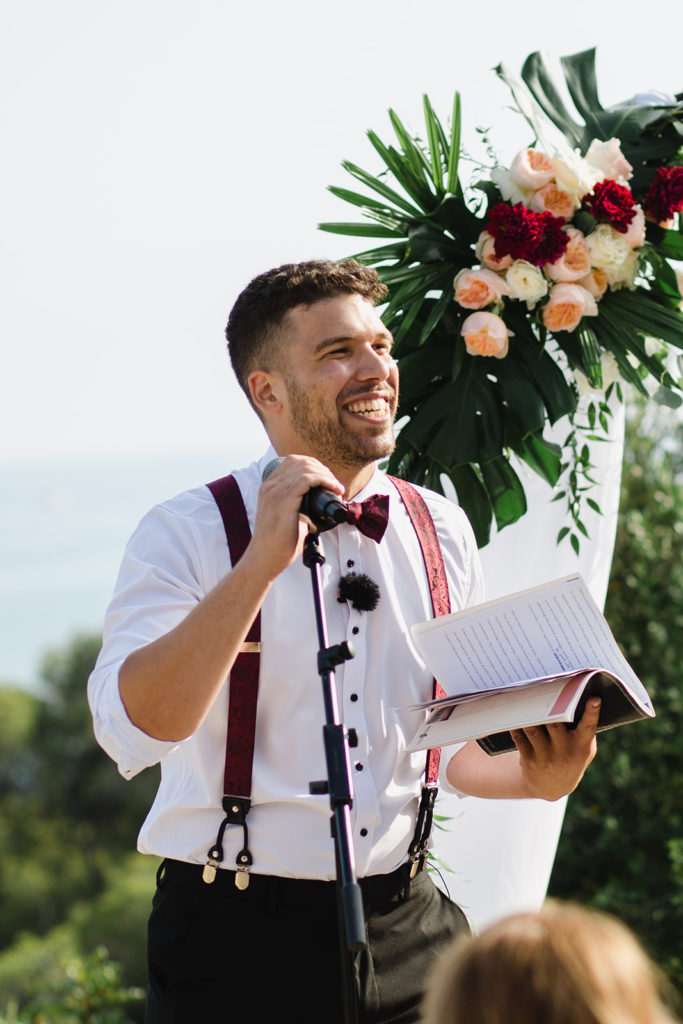 Tropical Wedding, officiant smiles before ceremony, casa del mar, sitges, spain