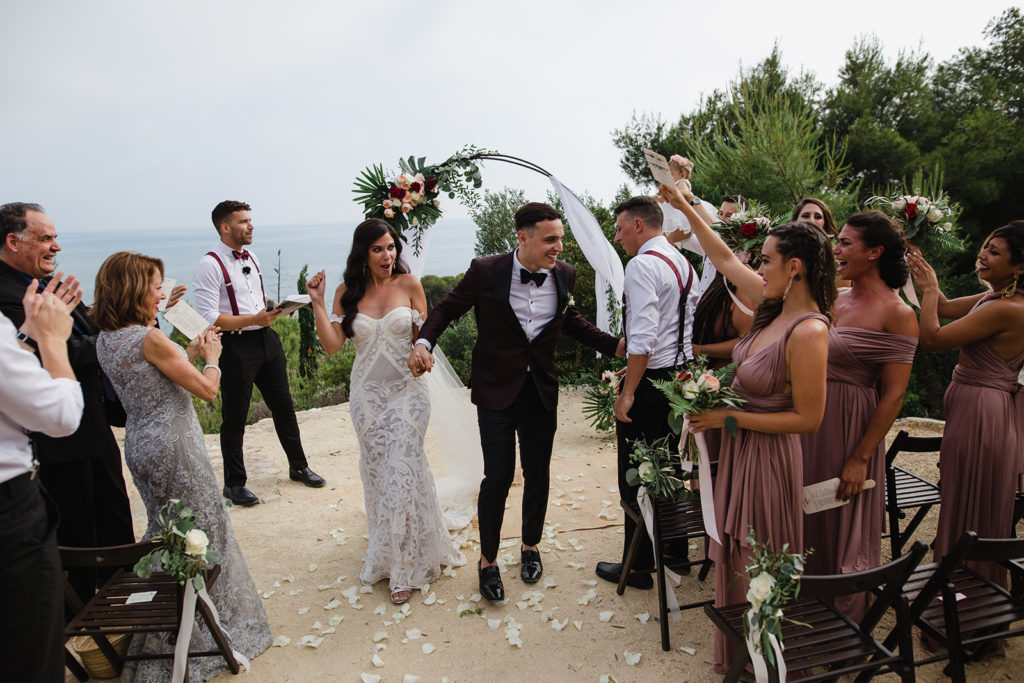 Tropical Wedding, bride and groom walk back down aisle at casa del mar, sitges, spain