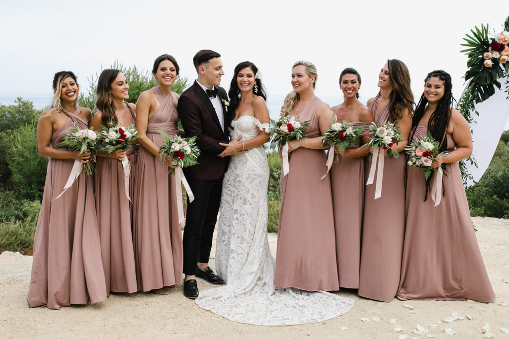 bride and groom with bridesmaids outside casa del mar, sitges, spain, barcelona brides