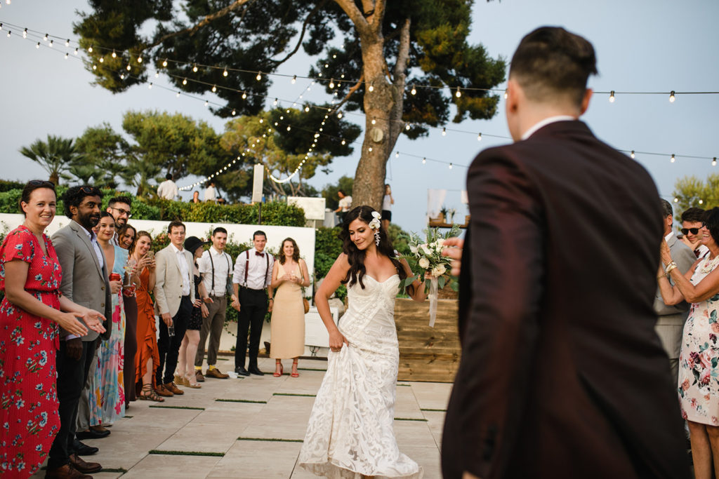 bride and groom have first dance outside casa del mar, barcelona brides