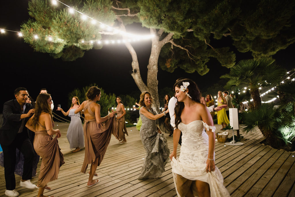 Tropical Wedding with bride and guests dancing in a conga line, casa del mar, barcelona brides