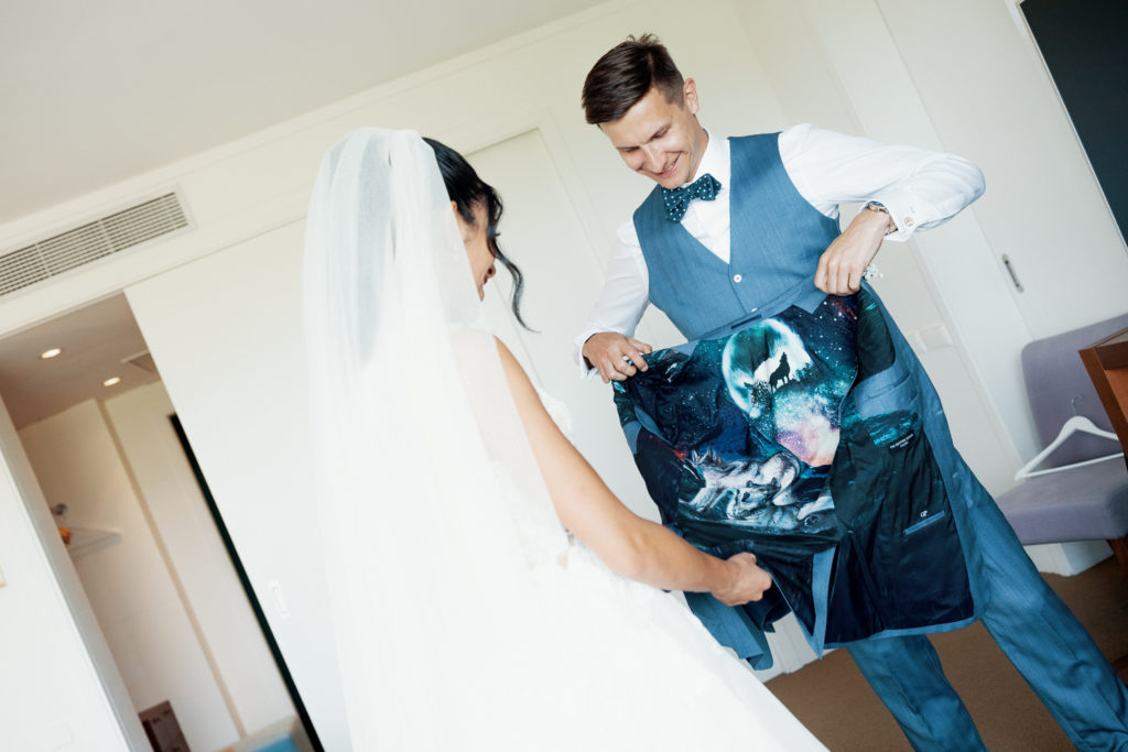 bride and groom look at gift, sitges spain, barcelona brides