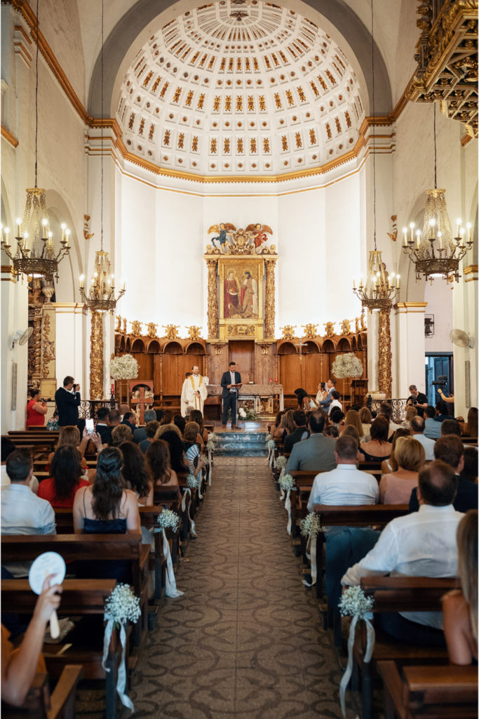 church filled with wedding guests in sitges, spain, barcelona brides