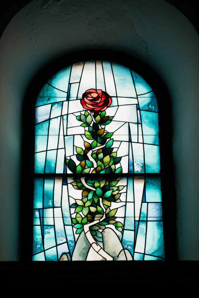 sitges church stained glass window with rose, spain