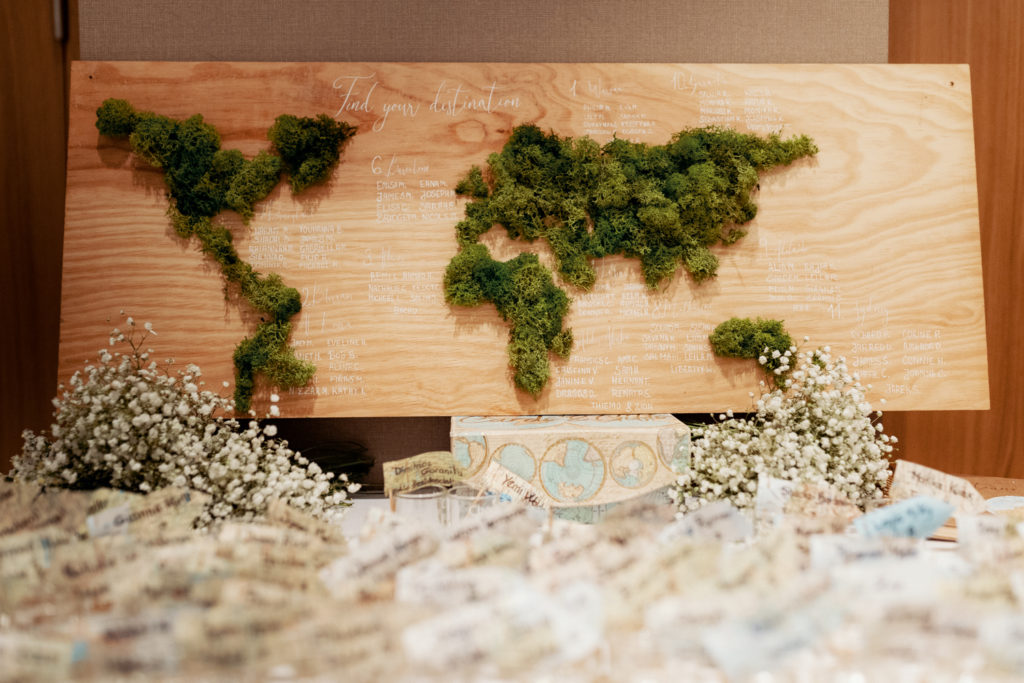 table setting map of world made of wood covered in moss, barcelona brides