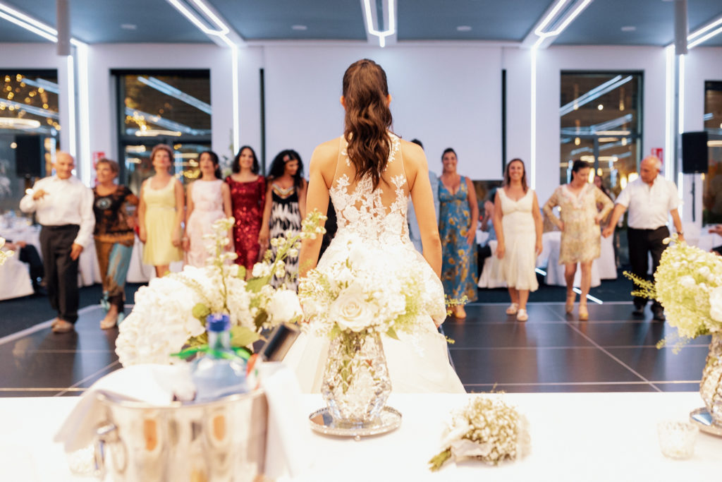 bride and guests dance on dancefloor, sitges, spain, barcelona brides