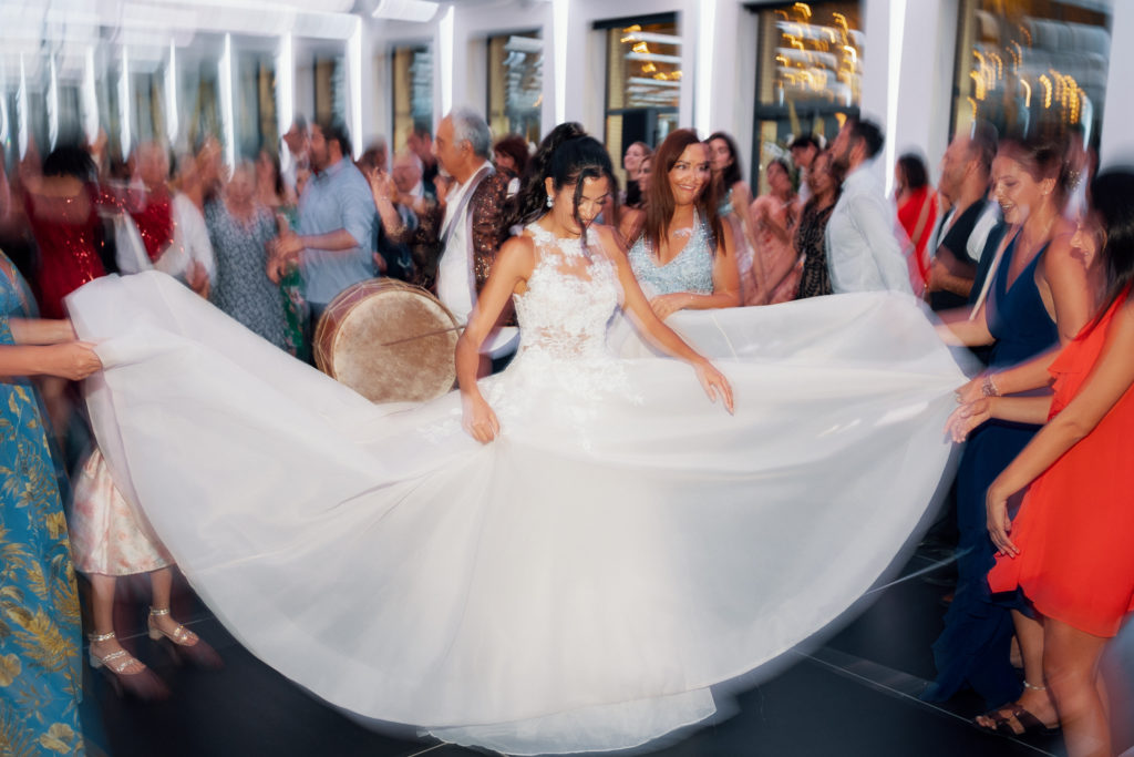 bride dances to lebanese drum music with wedding guests, sitges, spain, barcelona brides