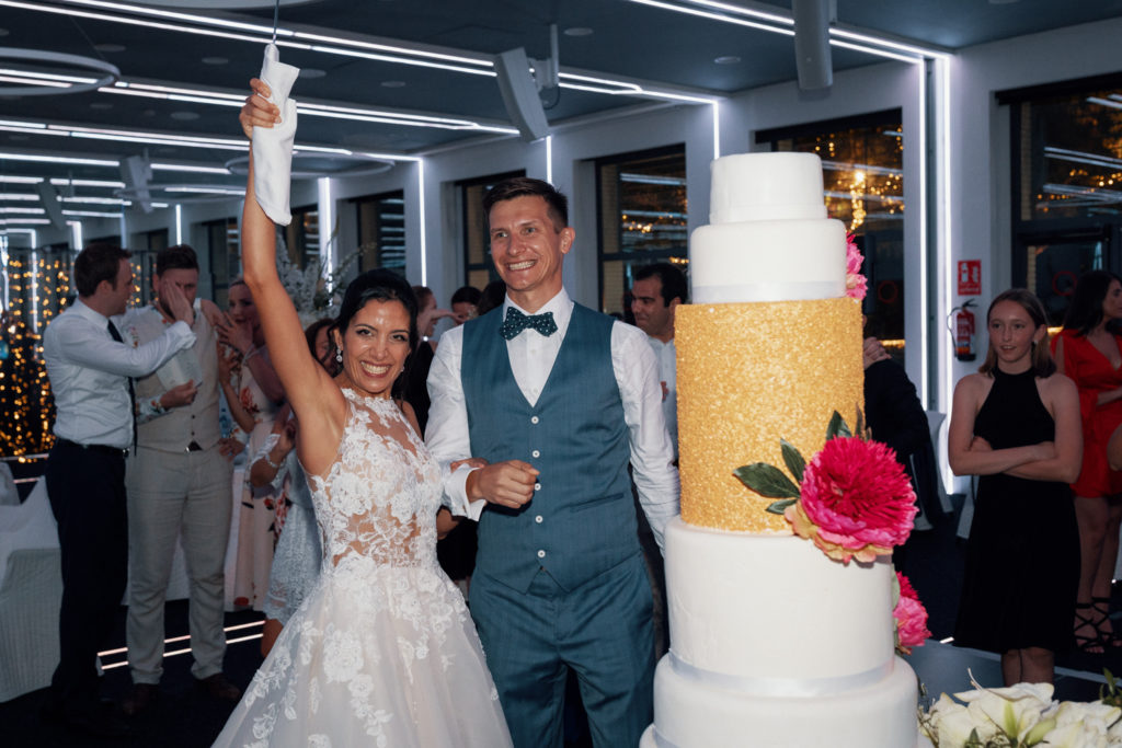 bride and groom cut 5 tier wedding cake, barcelona brides, sitges, spain