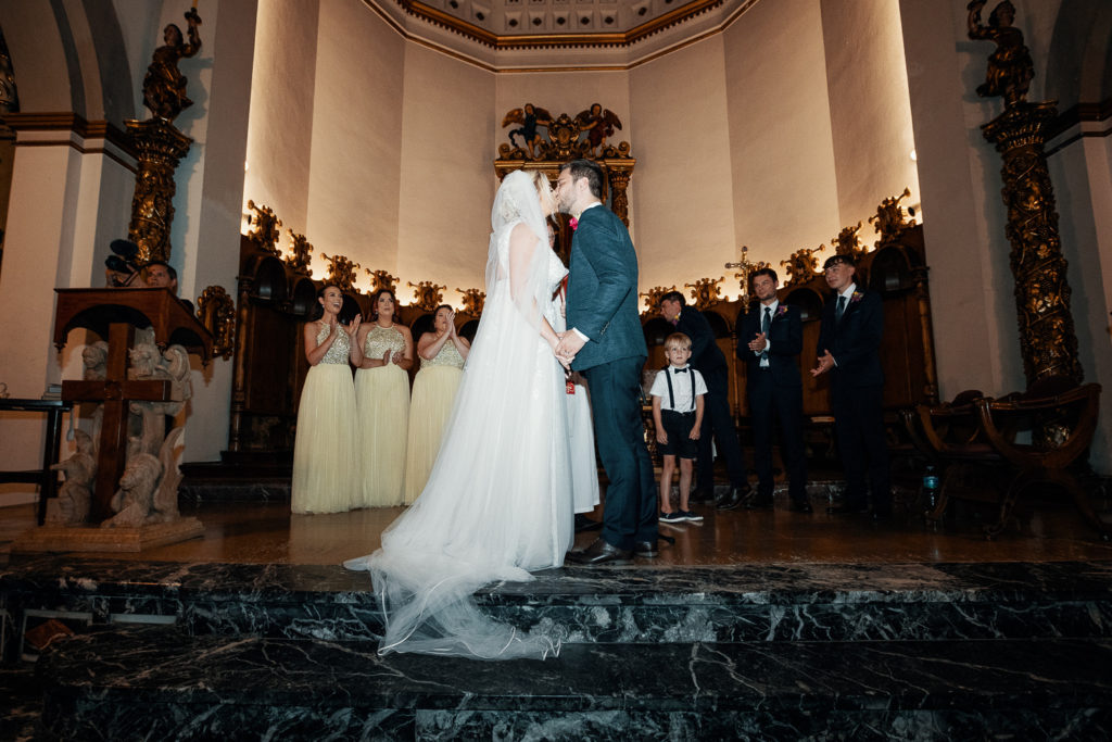 bride and groom kiss inside church, sitges, spain