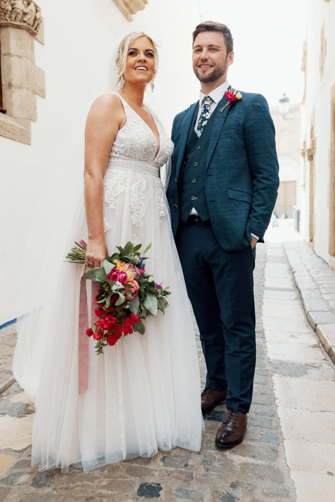 bride and groom on streets of sitges, spain, barcelona brides