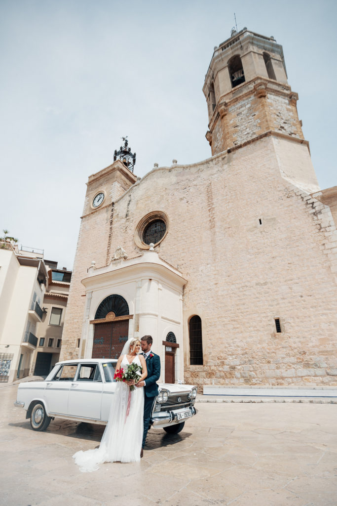 bride and groom outside church in sitges, spain, barcelona brides