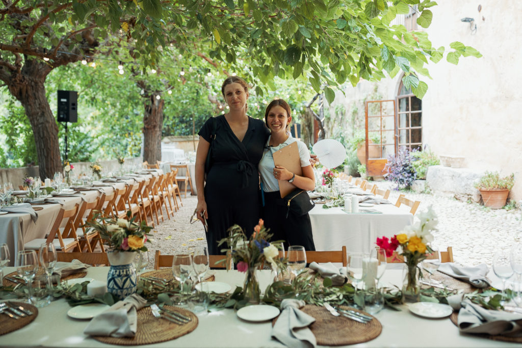 wedding planner and assistant setting up tables, villa catalina, barcelona brides