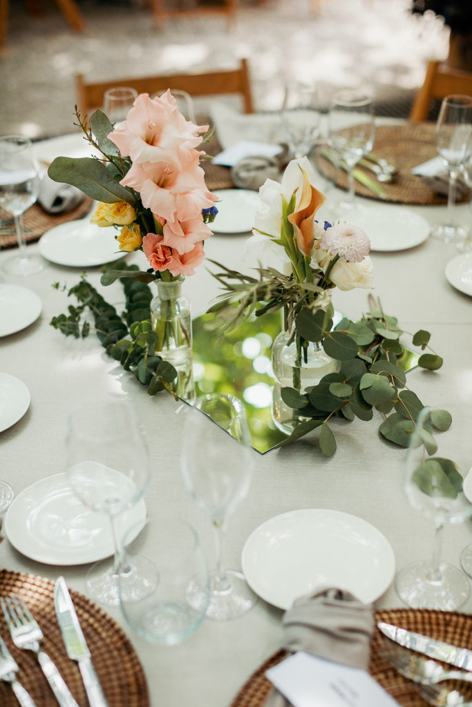wedding table setting with light pink and white flowers in bud vases, villa catalina, barcelona brides