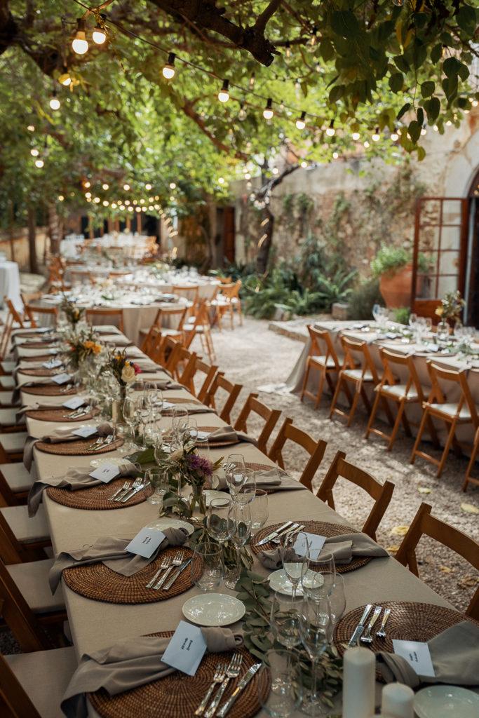 wedding dining tables under the trees villa catalina, barcelona brides