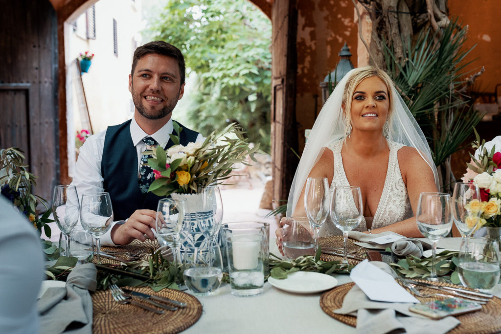 bride and groom smile at dinner table at venue villa catalina, sitges, spain, barcelona brides