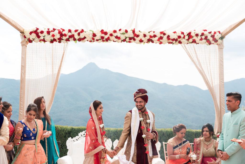 Hindu bride and groom beneath canopy