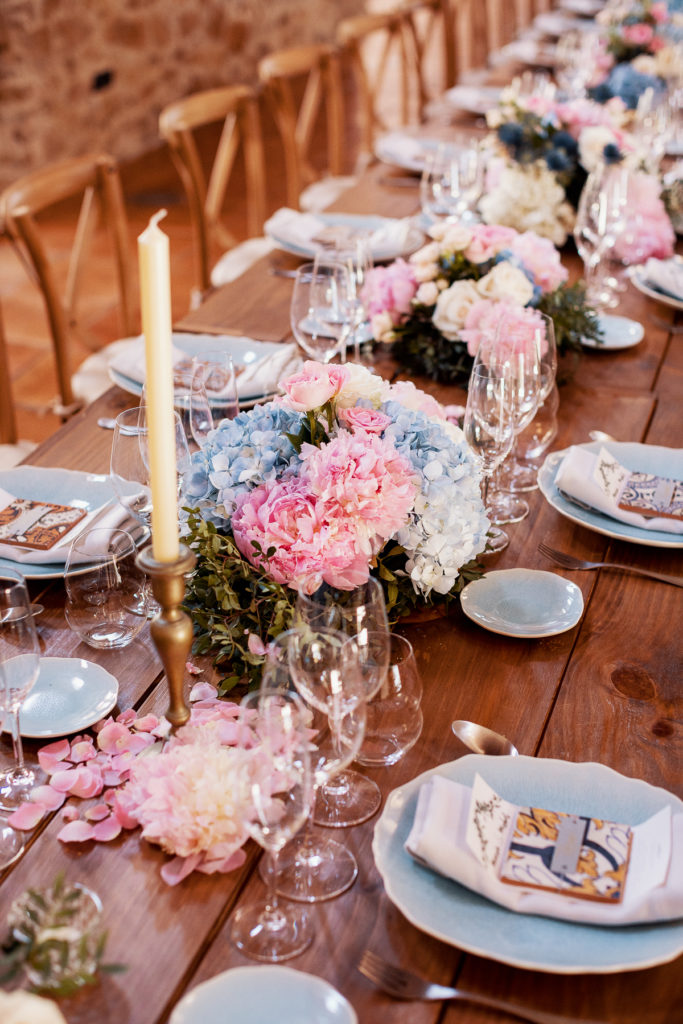 wedding dining table with blue and pink flowers, place settings, and candlesticks, Barcelona Brides