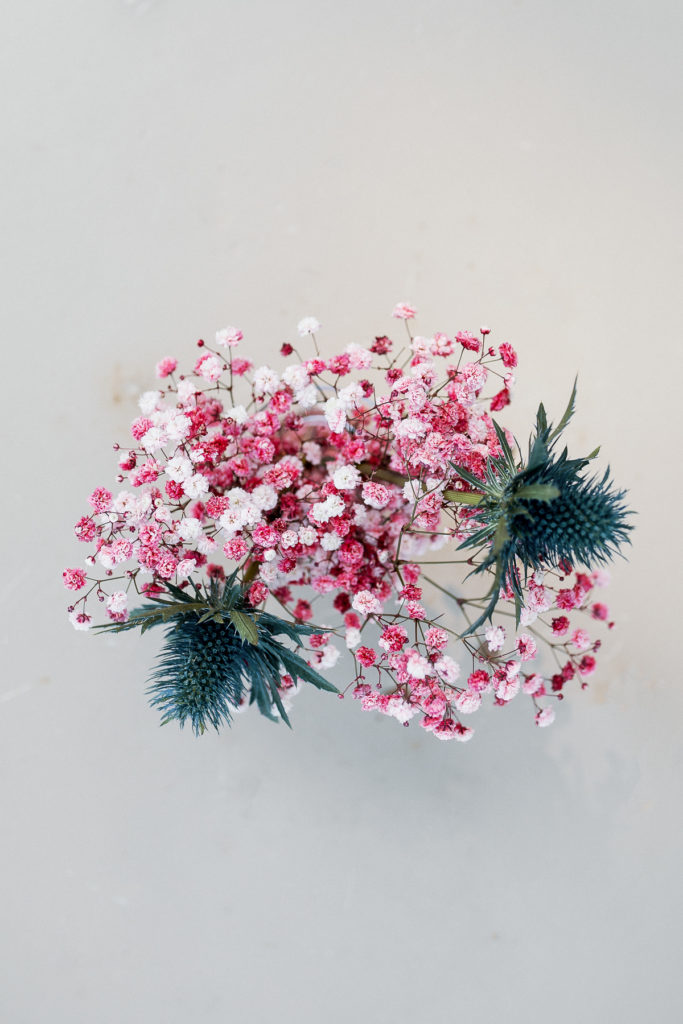 wedding floral arrangement with pink babys breath and blue thistle, Barcelona Brides