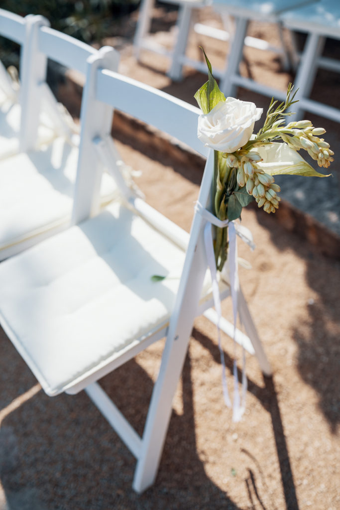 white chair decorated with white rose and flowers for wedding aisle, Balmes, Spain