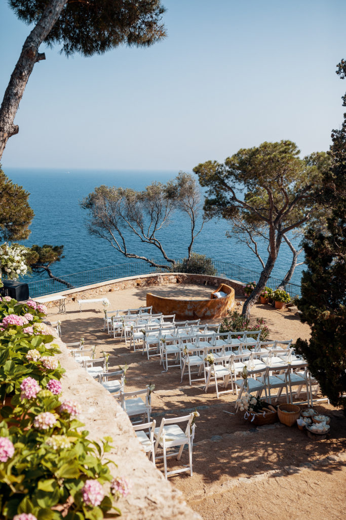 wedding setup with white chairs facing the sea at the convent of Balmes, Spain