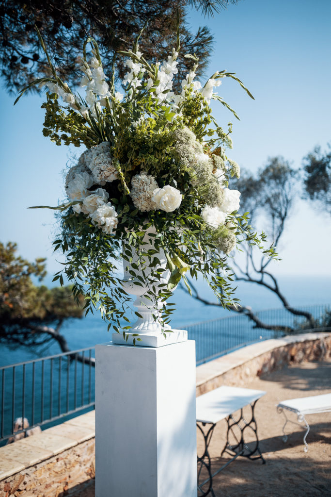 altar made of white pillar with white rose and flowers for wedding ceremony, Balmes, Spain