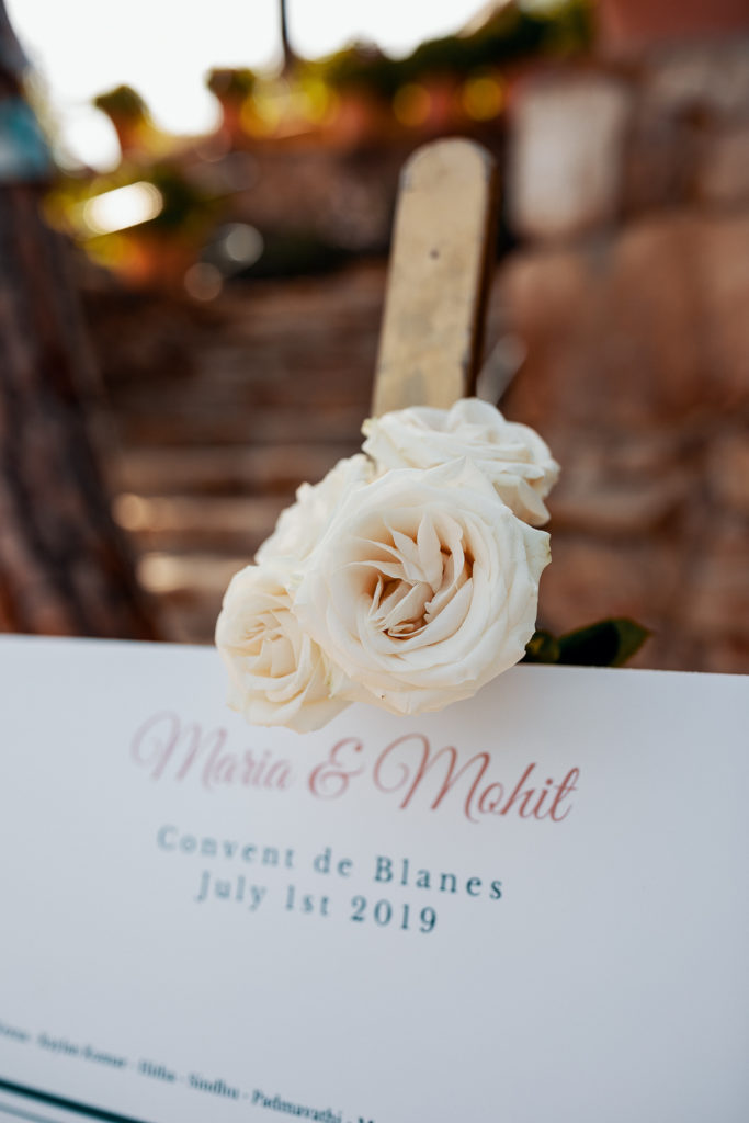 Maria and Mahit, Convent de Blanes, July 1st 2019 wedding sign with white rose, Barcelona Brides