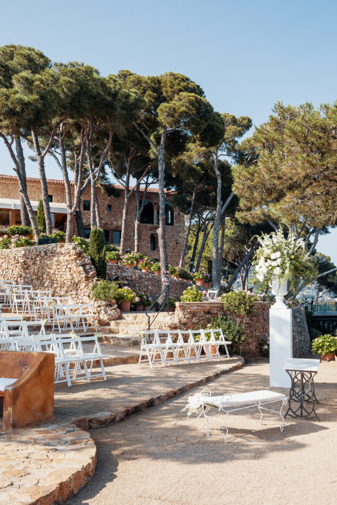 white wedding guest chairs on stairs of terrace at convent of Balmes, Spain