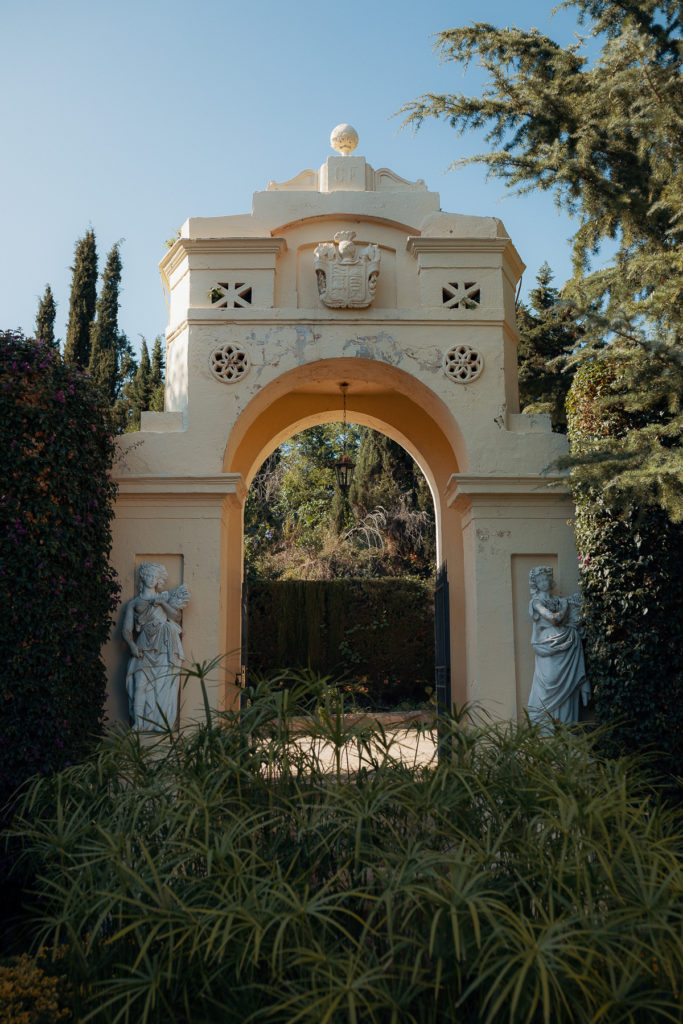 spanish archway with marble statues at the wedding venue in barcelona