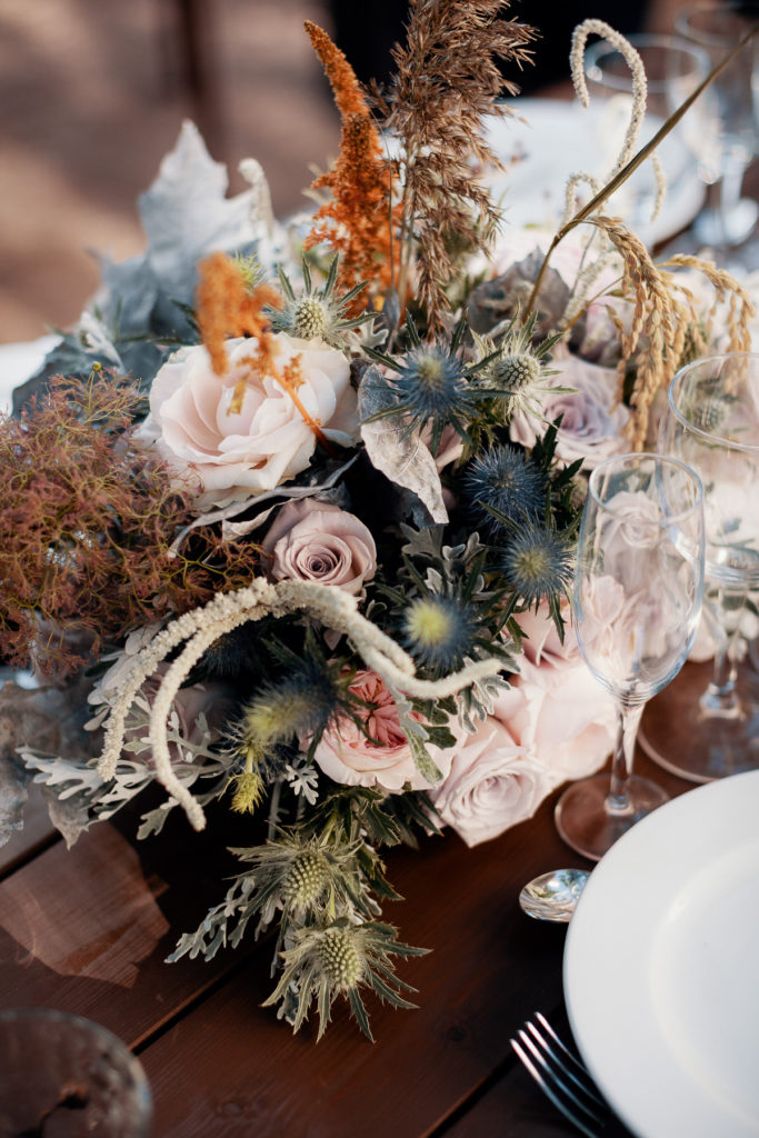 wedding floral arrangement with light pink flowers and wild grasses