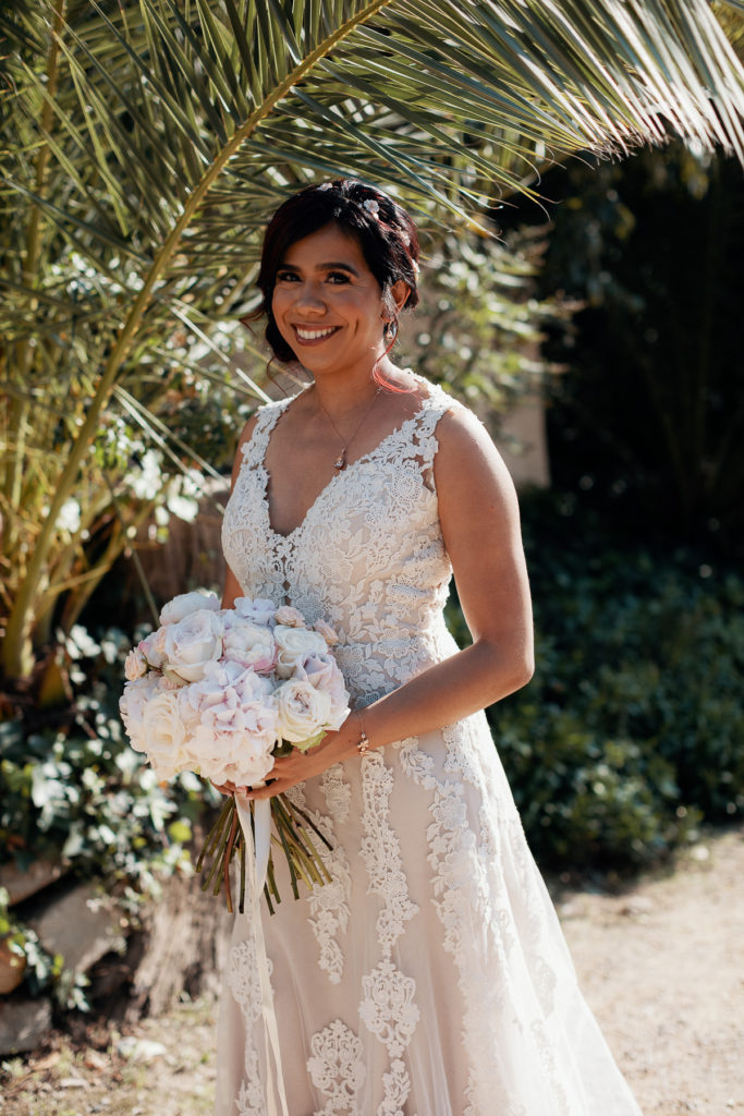 bride smiling in wedding dress with bouquet barcelona spain