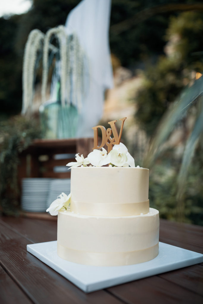 white two tier wedding cake with initials D and V on the top