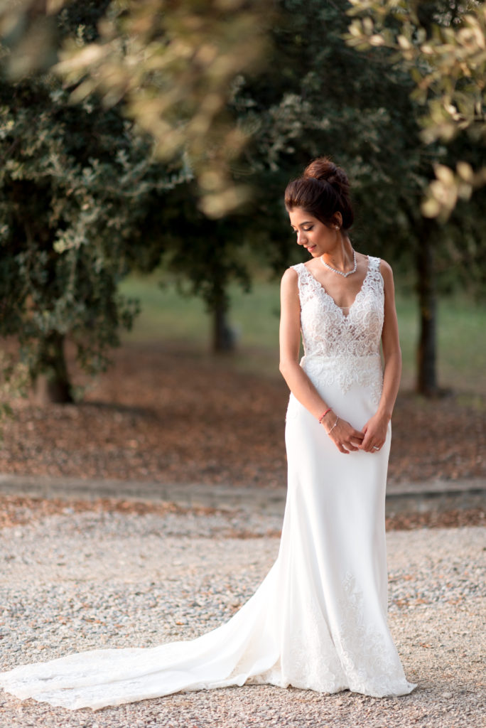 bridal portrait in lace gown beneath trees