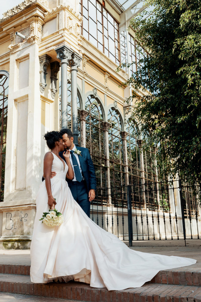 bride and groom embrace in front of historical building barcelona spain