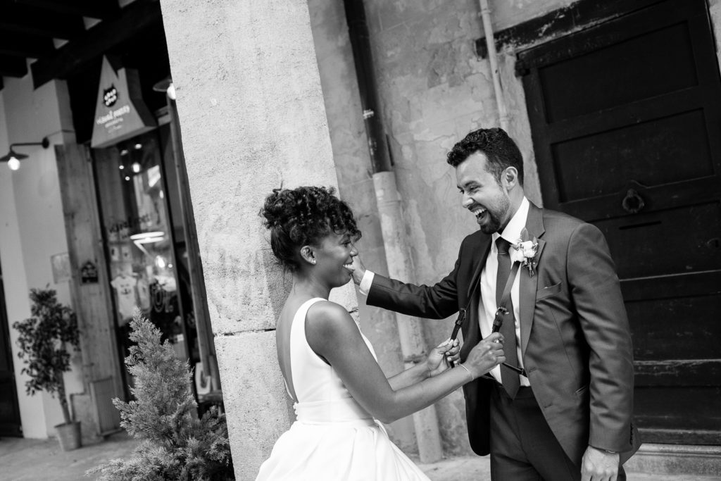 bride and groom smile and laugh outside on barcelona streets