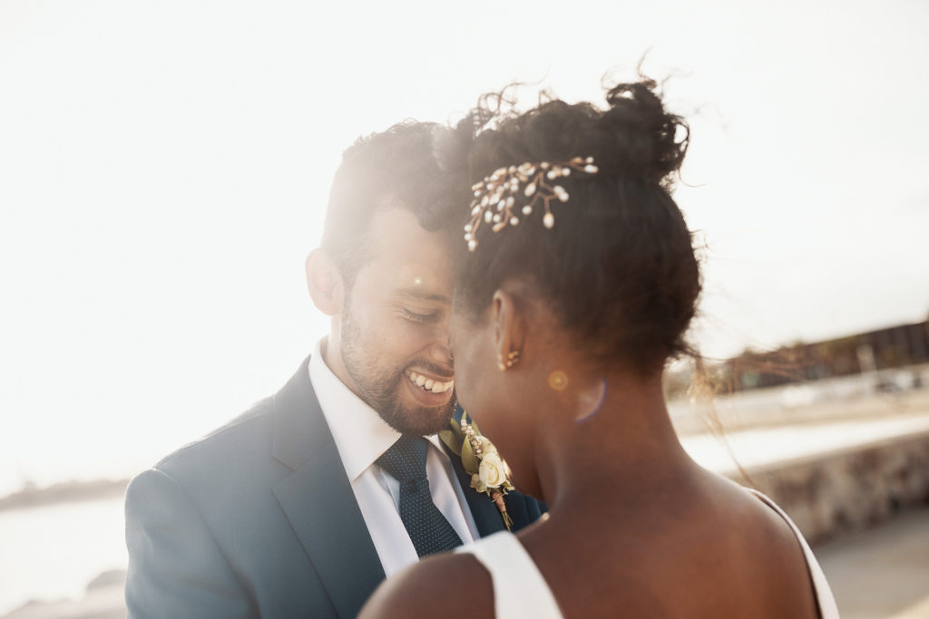 bride and groom smile with foreheads pressed together