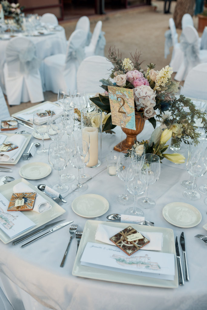 wedding table with map table number, floral centerpiece, and tile place cards, barcelona brides