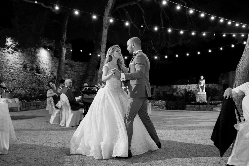bride and groom first dance outside castell de tamarit, barcelona, spain