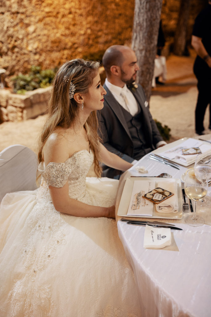 bride and groom at wedding dinner, castell de tamarit, barcelona brides