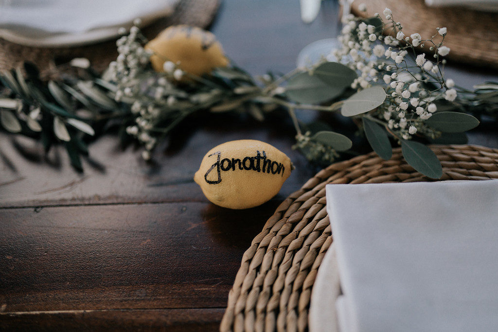 table setting with simple greenery and lemon name tags, casa felix, barcelona brides