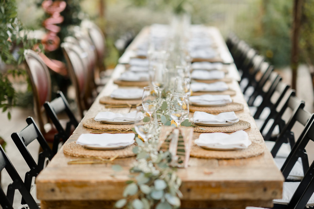 table setting with natural mats and white napkins, casa felix, barcelona brides
