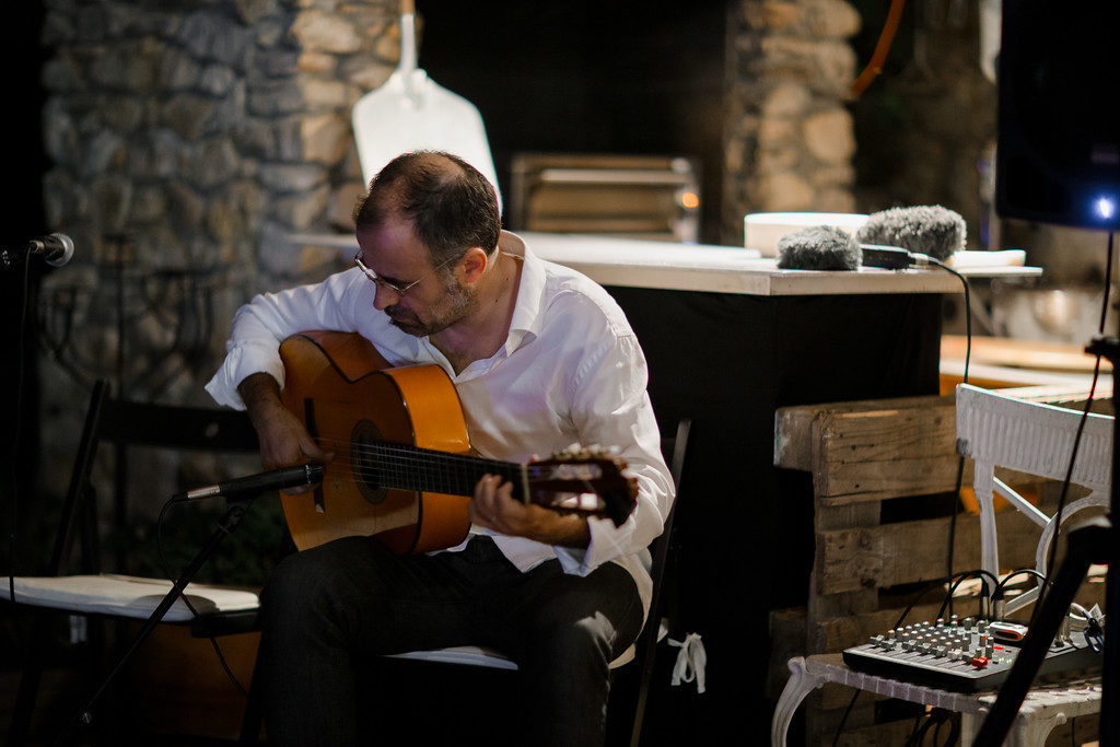 flamenco guitarist performs for wedding guests, casa felix, barcelona, spain