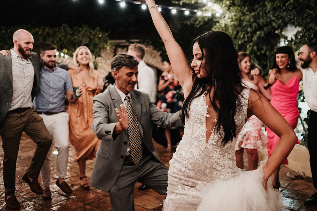 bride dances with wedding guests, almiral de la font, barcelona, spain
