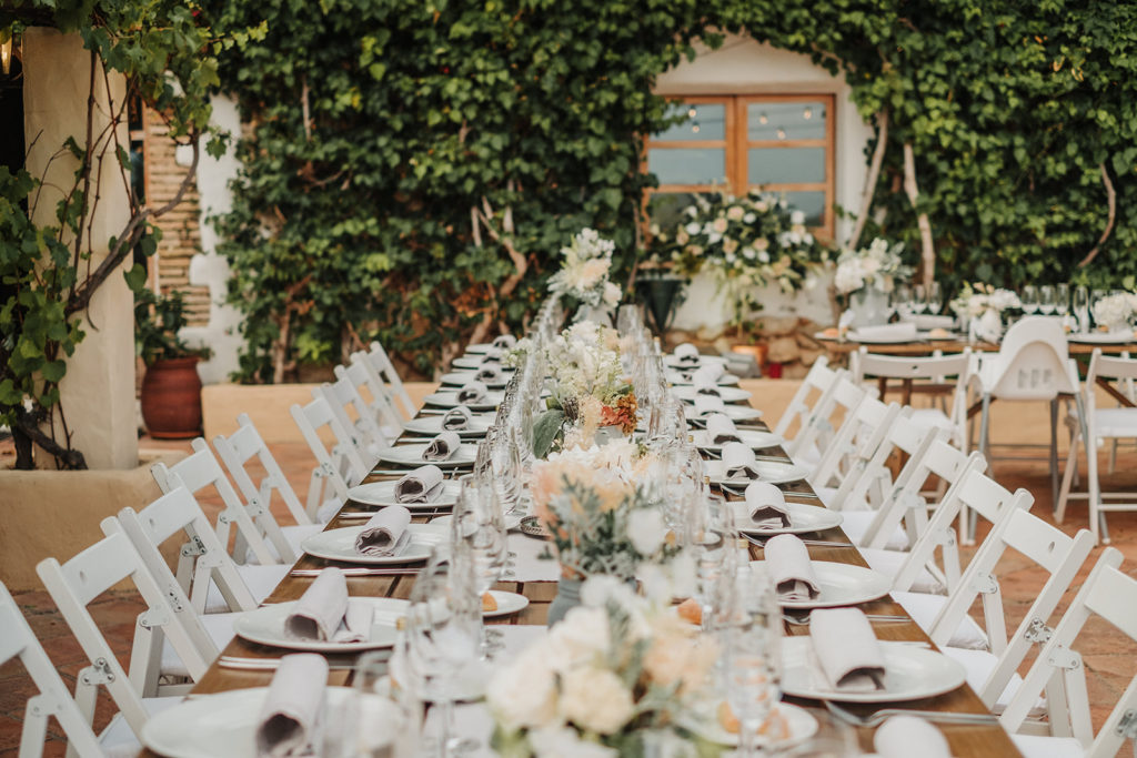wedding dining table with white place settings, and neutral florals in center, almiral de la font, barcelona brides