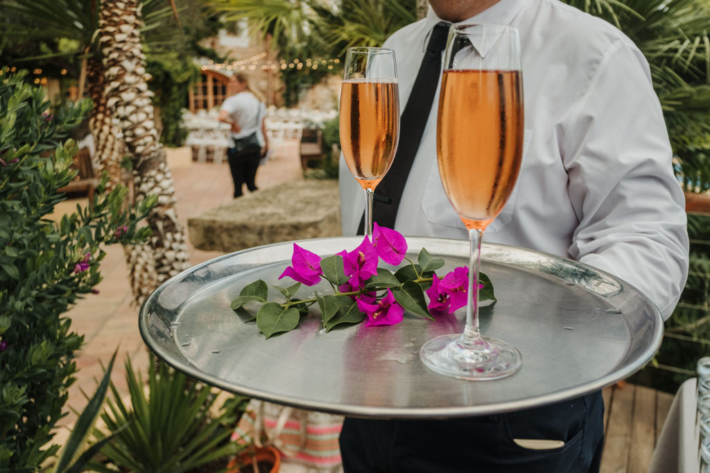 two glass of cava on a tray with flowers, almiral de la font, barcelona brides