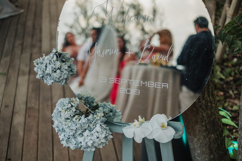 welcome yasmin and david sign on mirror with flowers, almiral de la font, barcelona brides