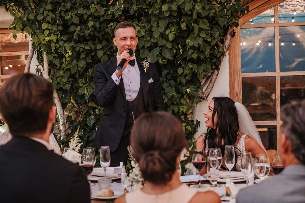 groom gives speech at reception outside almiral de la font, barcelona, spain